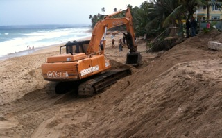 Bulldozers on Sandy Beach